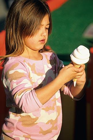 image 7-601-73 California, Santa Cruz, Santa Cruz Beach Boardwalk, girl with ice cream cone