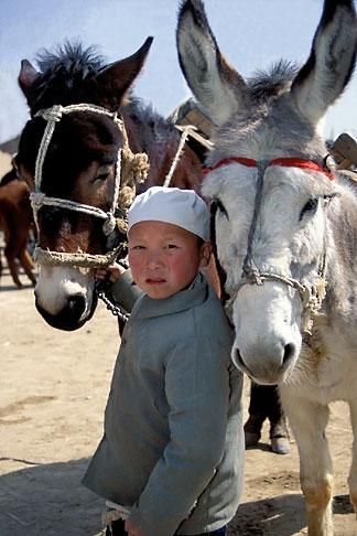 image 4-114-24 China, Gansu Province, Young Hui boy, Farmers market, Linxia