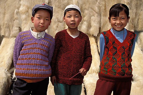 image 4-117-2 China, Gansu Province, Children and lambskins, Linxia