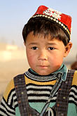 hat stock photography | China, Turpan, Uighur boy near the city of Gaochang, image id 4-155-30