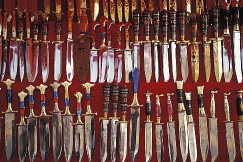 image 4-169-35 China, Urumqi, Uighur daggers for sale at street stall