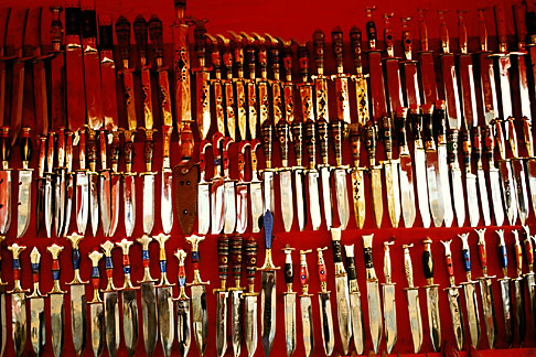image 4-170-5 China, Urumqi, Uighur daggers for sale at street stall