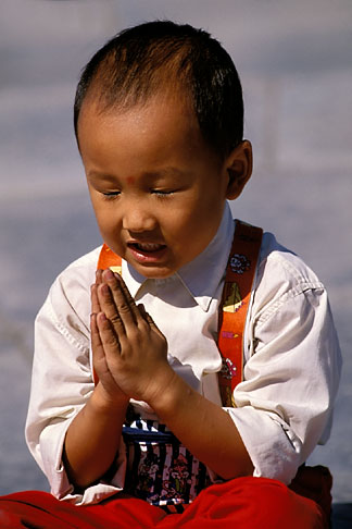 image 4-329-30 China, Beijing, Young boy with hands folded