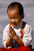 focus stock photography | China, Beijing, Young boy with hands folded, image id 4-329-30
