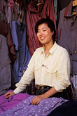 fabric for sale stock photography | China, Beijing, Shopkeeper, Wangfujing, image id 4-333-33