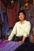 fabric for sale stock photography | China, Beijing, Shopkeeper, Wangfujing, image id 4-334-2