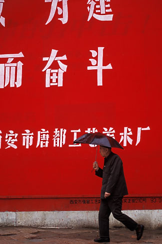 image 4-358-69 China, Xian, Street scene, man with umbrella