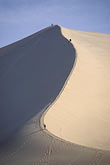 undulate stock photography | China, Dunhuang, Climbing the Mingsha sand dunes , image id 4-387-14
