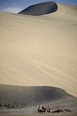 far away stock photography | China, Dunhuang, Camel caravan, Mingsha sand dunes , image id 4-387-4