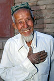 salutation stock photography | China, Turpan, Uighur man in village of Astana, image id 4-395-24