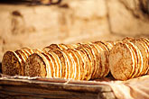 horizontal stock photography | China, Kashgar, Bread (nan) for sale, Sunday market, image id 4-412-4