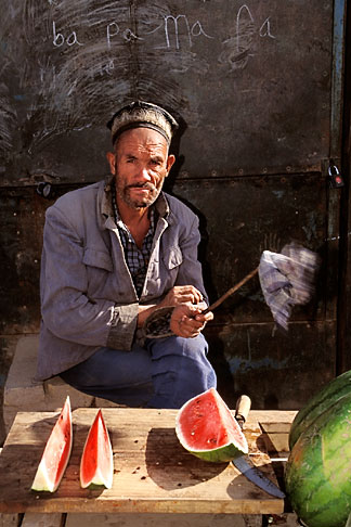 image 4-423-29 China, Kashgar, Man selling watermelon