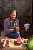 portrait stock photography | China, Kashgar, Man selling watermelon, image id 4-423-29