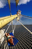 vertical stock photography | St. Vincent, Grenadines, Royal Clipper, relaxing on the bowsprit net, image id 3-610-18