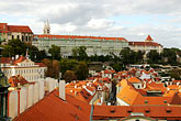 castle stock photography | Czech Republic, Prague, View across rooftops to Hradcany Castle, image id 4-960-688