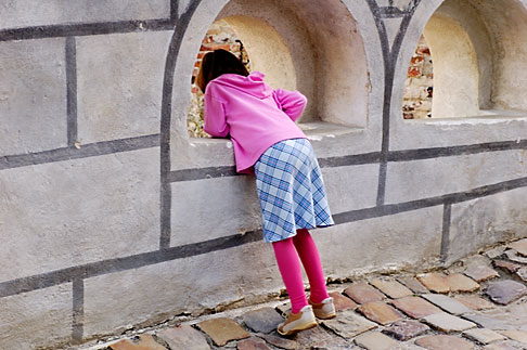 image 4-960-7140 Czech Republic, Cesky Krumlov, Girl look out from castle