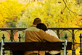 hug stock photography | Czech Republic, Prague, Couple on park bench, image id 4-960-758