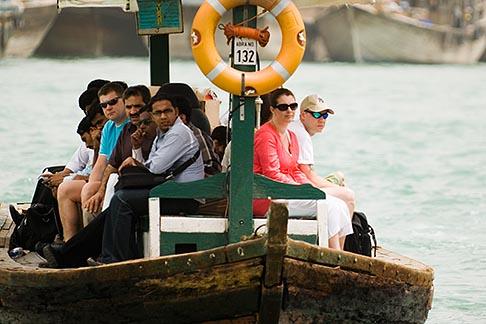 image 8-730-1475 United Arab Emirates, Dubai, Passengers on Small Boat or Abra crossing Dubai Creek