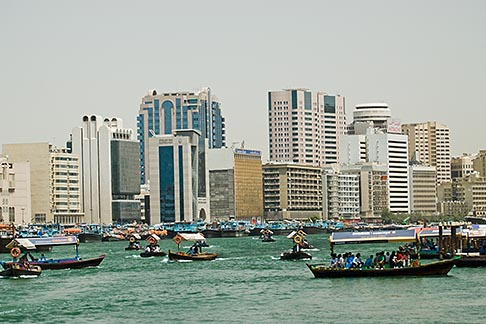 image 8-730-1593 United Arab Emirates, Dubai, Deira skyline and abra ferries on Dubai Creek