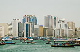 deira skyline and abra ferry on dubai creek stock photography | United Arab Emirates, Dubai, Deira skyline and abra ferries on Dubai Creek, image id 8-730-1593