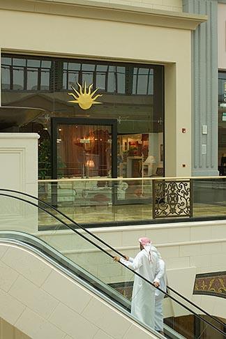 image 8-730-186 United Arab Emirates, Dubai, Emirati men on escalator, shopping mall