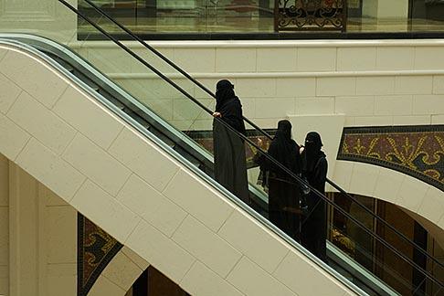 image 8-730-190 United Arab Emirates, Dubai, Emirati women on escalator, shoppng mall