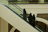 chador stock photography | United Arab Emirates, Dubai, Emirati women on escalator, shoppng mall, image id 8-730-190