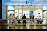 thobe stock photography | United Arab Emirates, Dubai, Customers at boutique, shopping mall, image id 8-730-200