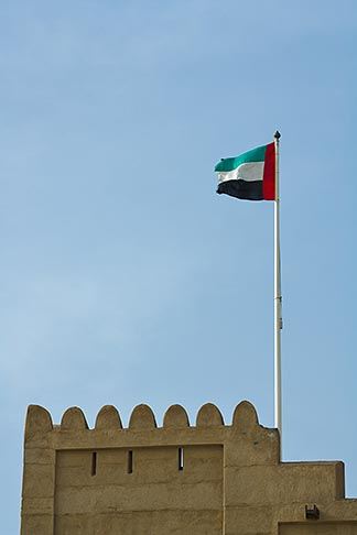 image 8-730-400 United Arab Emirates, Fujairah, Fujairah Fort, crenellated watchtower with UAE flag