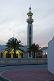 religion stock photography | United Arab Emirates, Sharjah, Community mosque and minaret at dusk, image id 8-730-450