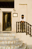 stand stock photography | United Arab Emirates, Dubai, Young man on stairway, image id 8-730-483