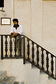 vertical stock photography | United Arab Emirates, Dubai, Young man on stairway, image id 8-730-488