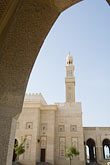 vertical stock photography | United Arab Emirates, Dubai, Mosque archway and minaret, Jumeirah, image id 8-730-9002