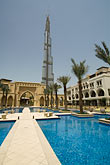 vertical stock photography | United Arab Emirates, Dubai, Burj Dubai, and Al Manzil hotel pool, image id 8-730-9209