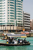 vertical stock photography | United Arab Emirates, Dubai, Passengers on Small Boat or Abra crossing Dubai Creek, image id 8-730-9305
