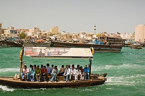 image 8-730-9321 United Arab Emirates, Dubai, Passengers on Small Boat or Abra crossing Dubai Creek