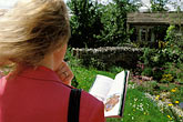 look stock photography | England, Chelsea Flower Show, Yorkshire Forward Garden, Woman viewing garden, image id 3-754-26