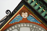 angel decorations stock photography | England, Chester, Eastgate Clock, angel decorations, image id 7-695-7349