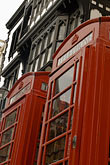 vertical stock photography | England, Chester, Telephone boxes and Tudor house, image id 7-695-9954
