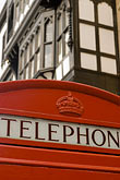vertical stock photography | England, Chester, Telephone box and Tudor house, image id 7-695-9957