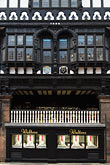 vertical stock photography | England, Chester, Tudor building with shopfront and timbers, image id 7-695-9966