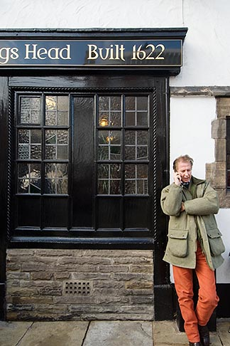 image 7-695-9970 England, Chester, Man on phone outside pub