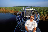man stock photography | Florida, Orlando, Cypress Lake, Airboat, image id 2-502-28