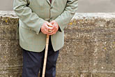 horizontal stock photography | France, Normandy, Bayeux, Man with cane, hands, image id 6-450-1050