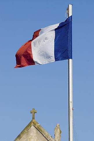 image 6-450-1156 France, Normandy, St Vaast La Hougue, Flag and chapel