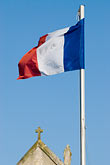 french flag stock photography | France, Normandy, St. Vaast La Hougue, Flag and chapel, image id 6-450-1156