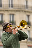 one man only stock photography | France, Paris, Street band trombone player, image id 6-450-5793