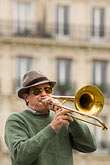 one man only stock photography | France, Paris, Street band trombone player, image id 6-450-5801