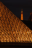 vertical stock photography | France, Paris, Musee du Louvre, Pyramide, night, and Eiffel tower, image id 6-450-630