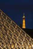 three sided stock photography | France, Paris, Musee du Louvre, Pyramide, night, and Eiffel tower, image id 6-450-631